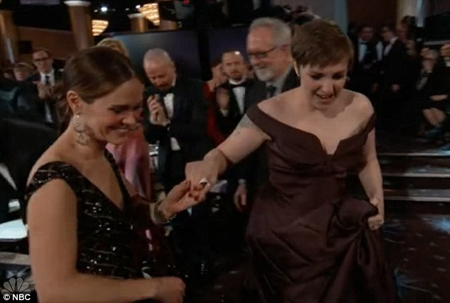 Struggle street: Lena Dunham, dressed in a floor-length, custom made Zac Posen gown, looked every bit a bona-fide Hollywood glamazon at last night's Golden Globes. But her footwear, sky-scraping Christian Louboutin's, gave her away