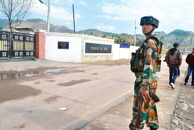 An Indian Army soldier patrolling near the Line of Control trade centre at the Chakan Da Bagh