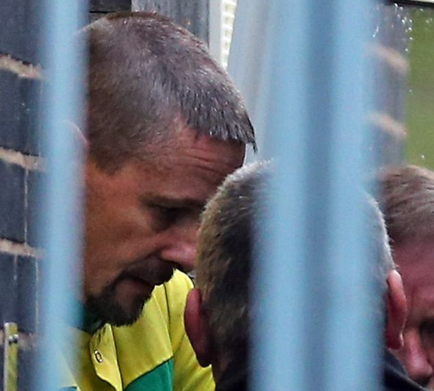 'Probably responsible': Mark Bridger, 46, has pleaded not guilty to the murder of April Jones. The former lifeguard is pictured right leaving Mold Crown Court yesterday