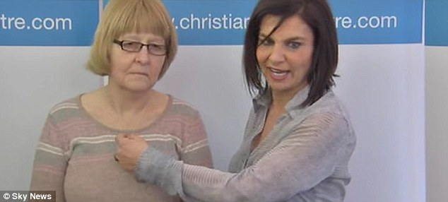 Lost: Andrea Williams of the Christian Legal Centre holds the cross of Shirley Chaplin, whose complaint about not being able to wear it at work in a hospital was not upheld