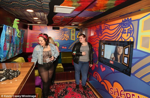 Fun house: Some fans get to check out the interior of the bus and they look impressed