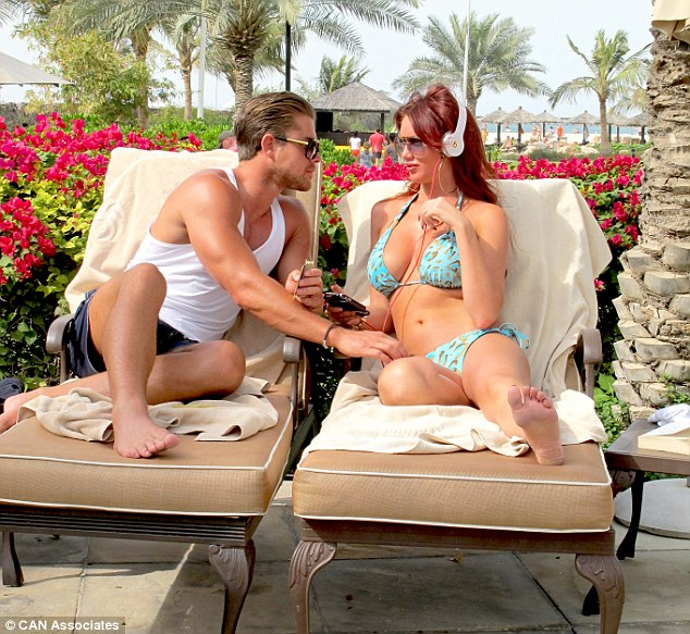 The look of love: The couple seemed to be enamoured with one another as they chatted away on their sun loungers