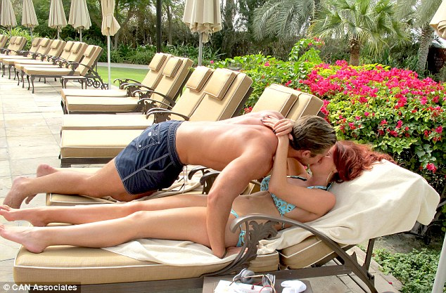 The heat is on! Amy Childs and her boyfriend David Peters enjoyed a steamy PDA-packed session as they relaxed poolside in Dubai