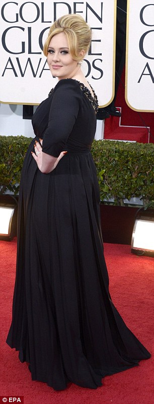 Faux mateyness: 'I'm just a new mum out for the night with my friend Ayda,' said Adele as she collected her Golden Globe