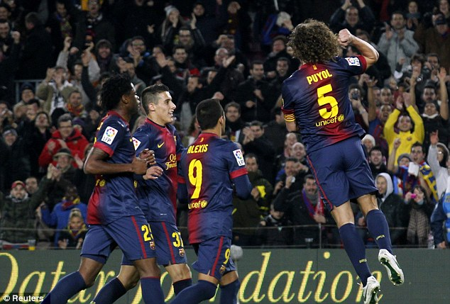 Quick: Puyol scored one minute after Messi to put Barcelona 2-1 ahead