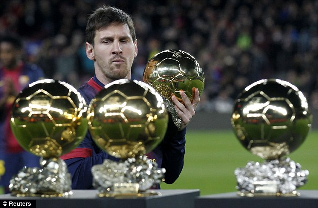 Is that heavy? Messi poses with his four Ballon d'Or trophies ahead of kick-off