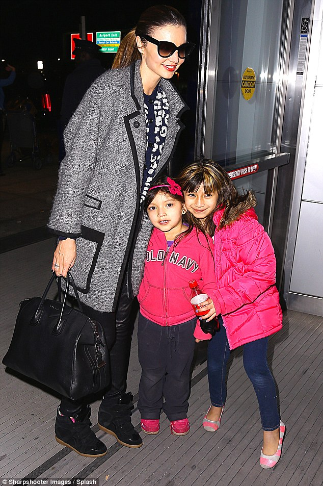 Friendly star: Miranda posed with some pint-sized fans when she later touched down at JFK airport