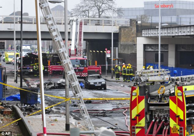 Devastation: Debris lies on the ground after a helicopter crashed into a construction crane
