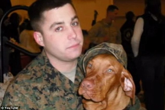Demons of war: Lance corporal Janos Victor Lutz, with his dog Kobe, took his own life on January 12 after struggling with PTSD since he returned from Afghanistan
