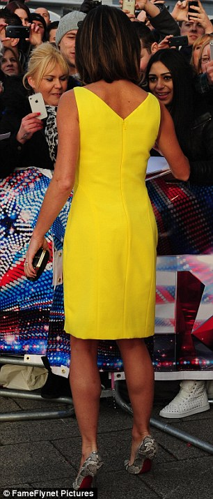 Mellow yellow: Amanda Holden looked summery in a Versace dress