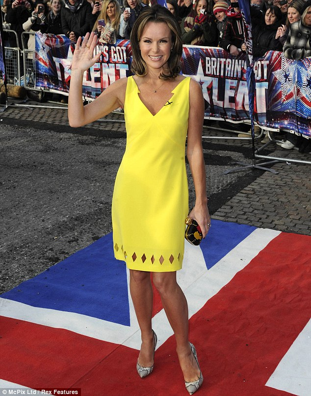 Little Miss Sunshine: Amanda Holden brightened up the miserable day with her bright yellow dress