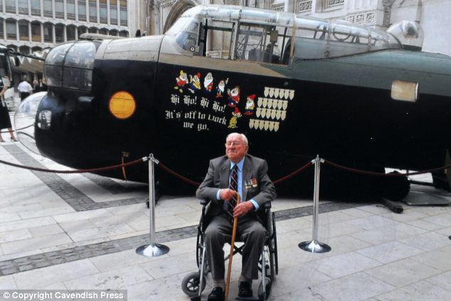 Louis Butler, pictured with a Lancaster Bomber at the London Guild Hall last year, was honoured personally by King George VI for his service during World War Two