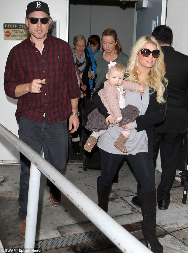 Happy family: Miss Simpson with her fiance of two years Eric Johnson and their daughter Maxwell