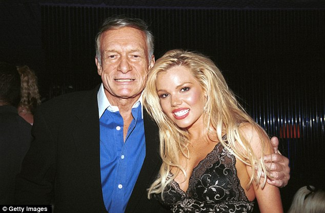 Bunny: Shannon, pictured right with Hugh Hefner, was the centerfold for Playboy's 50th anniversary edition in 2004