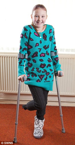 Smiling: Milly-Anne lost her foot after she was attacked by family pet Rory