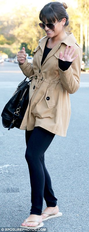 The right choice... almost: Lea Michele looked great in her stylish camel coat, but left her feet exposed and headed to the salon in flip flops