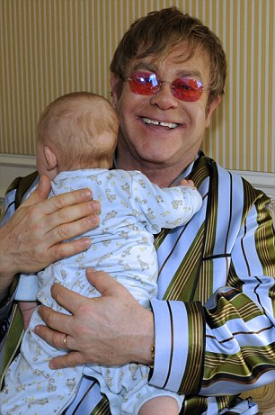 Doting dad: Elton has been names as father on both of his son's birth certificates, while David is listed as their mother