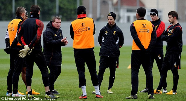Speaking out: Rodgers addresses his players at Melwood on Thursday afternoon