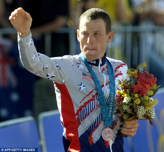 Lance Armstrong celebrates on the podium after winning the bronze medal in the men's individual time trial of the 2000 Sydney Olympic Games in Sydney 30 September 2000