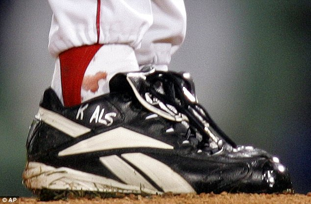 Blood money: Curt Schilling's bloody sock, shown here during the 2004 World Series, is expected to fetch more than $100,000
