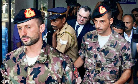 Italian marines Massimiliano Latorre (right) and Salvatore Girone come out of the office of the police commissioner in Kochi