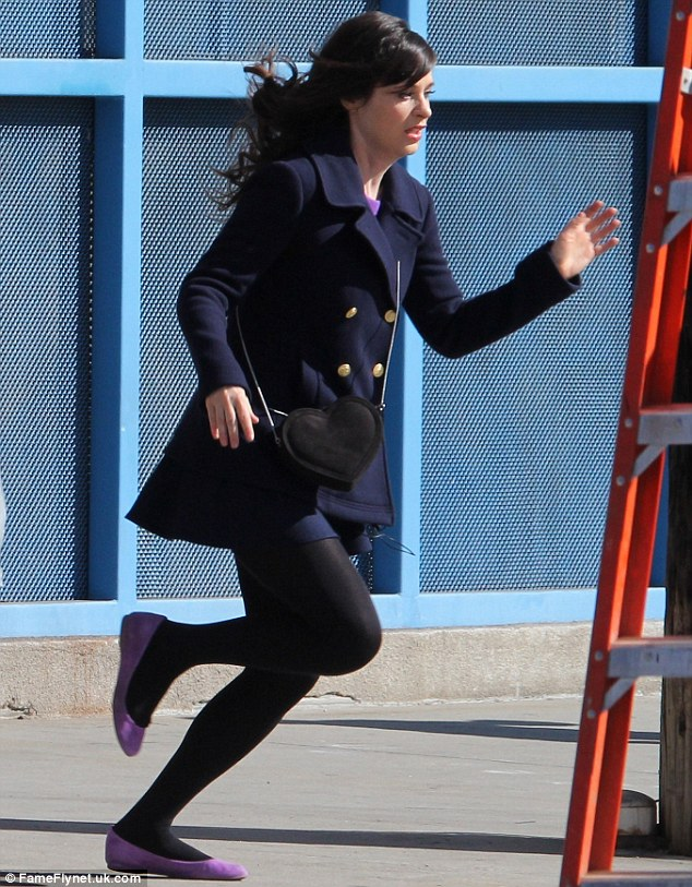 Run free: Zooey Deschanel filmed scenes for a new episode of New Girl in Los Angeles on Thursday