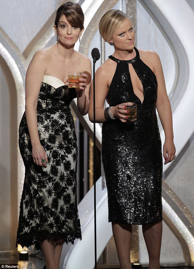 Where it all began: Co-host Tina Fey, seen left with Amy Poehler, made a joke that Taylor ought to steer clear of Sam, who was acting as Mr Golden Globe