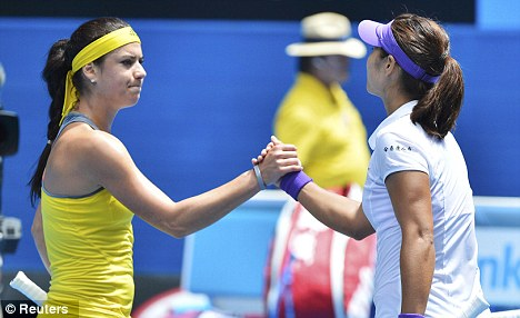 All over: Li Na shakes hands with Cirstea after her win