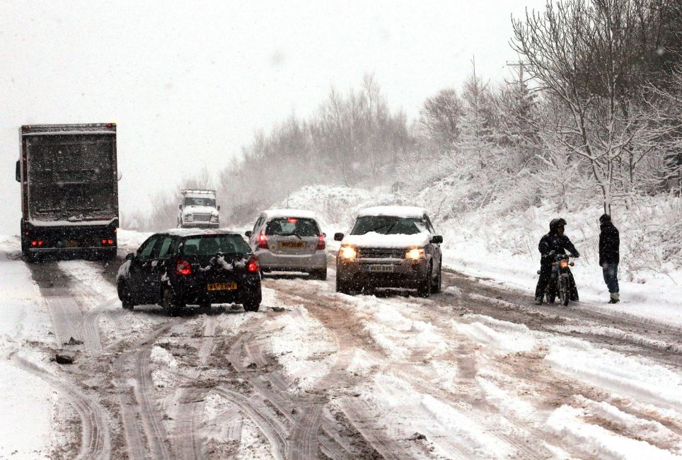 Losing control: Cars struggle to gain purchase on the snow-covered A367 near Bath