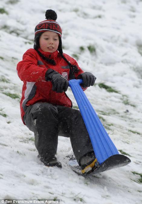 Sledging in the snow in Penarth near Cardiff