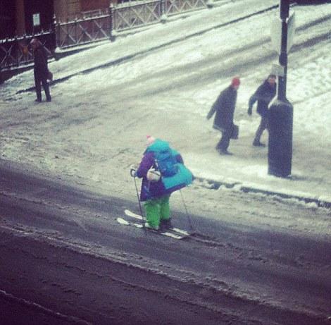 A man skis down Park Street in Bristol