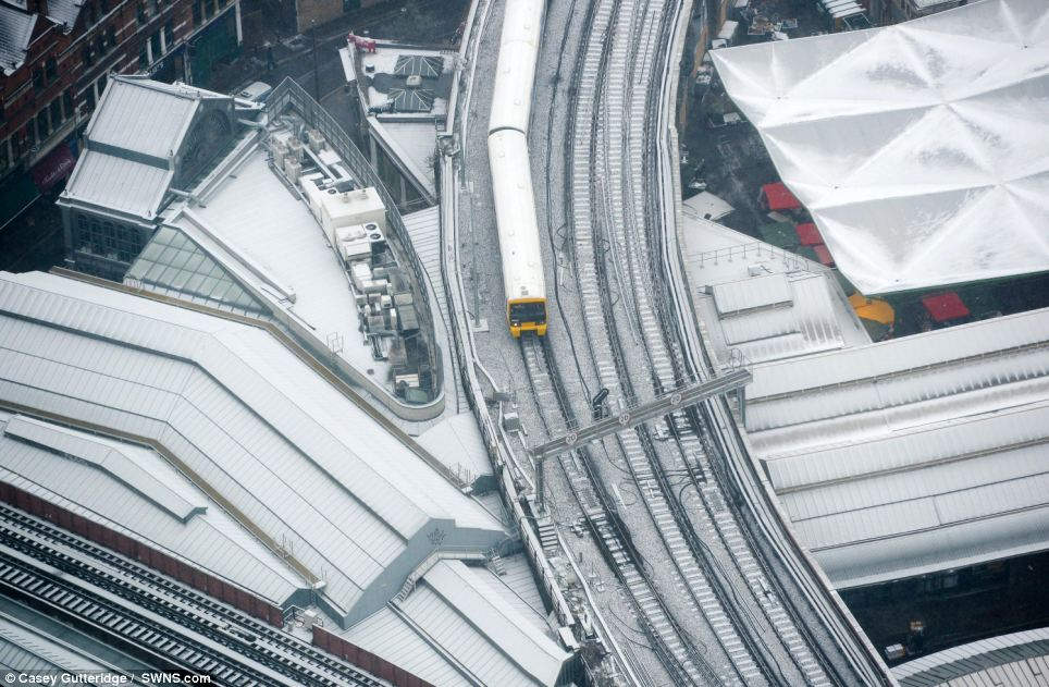 Fascinating view: Central London, seen from the viewing platform at the Shard, was covered by a layer of fresh snow by 8.30am