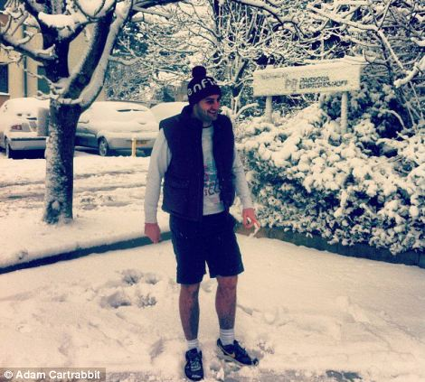 A man braves the snow in shorts in Bristol