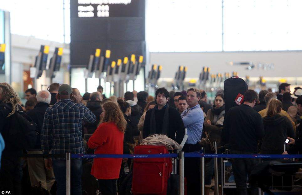 Passengers waiting to rebooked their flights in Terminal 5 at Heathrow Airport