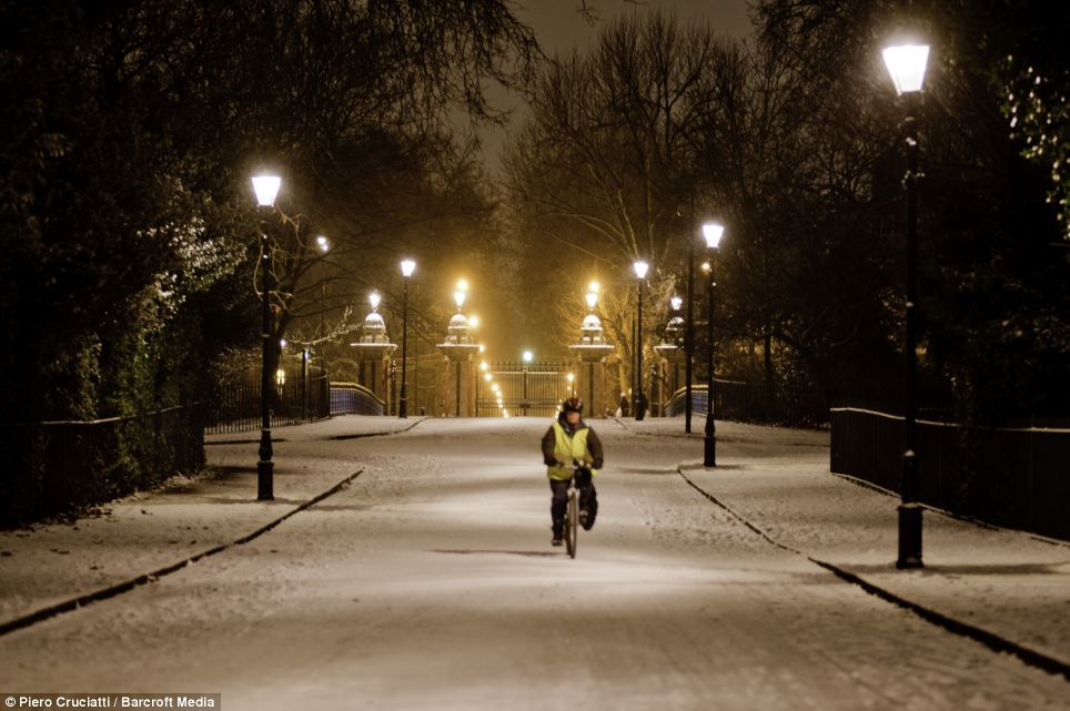 A snow covered Victoria Park in London as night descends on the capital