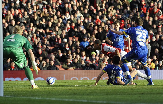 Precedent: Theo Walcott admitted that he dived to try and win a penalty against Leeds in January 2011