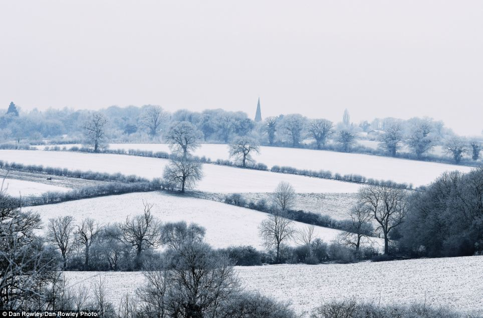 White and pleasant land: The fields around Thorpe Malsor in Northamptonshire were a sheet of white this morning, with more snow due later today
