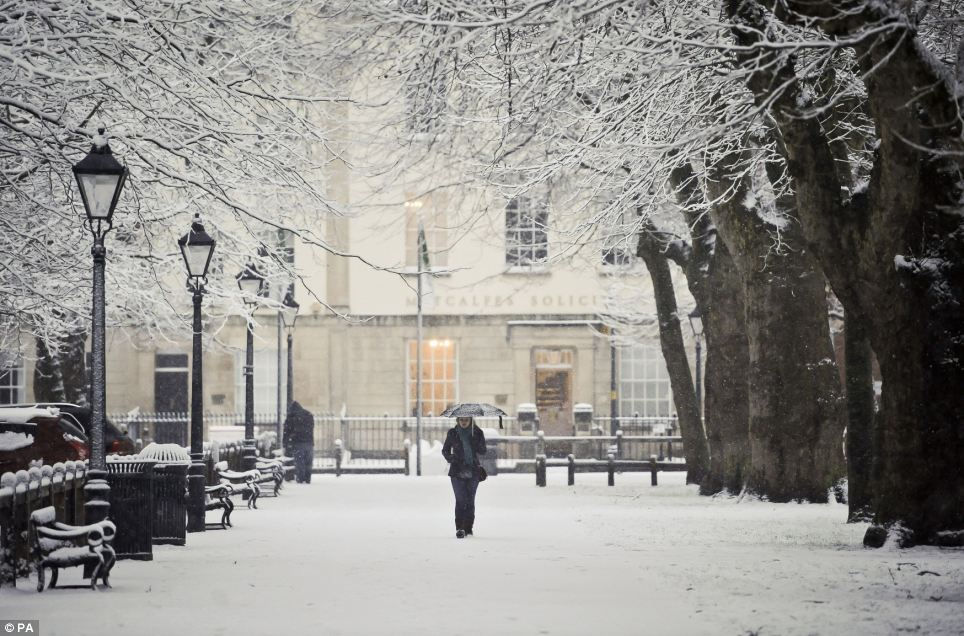 Blizzard bliss: A woman walks along a snow covered pathway in Bristol, where the weather caused disruptions on the railways and roads