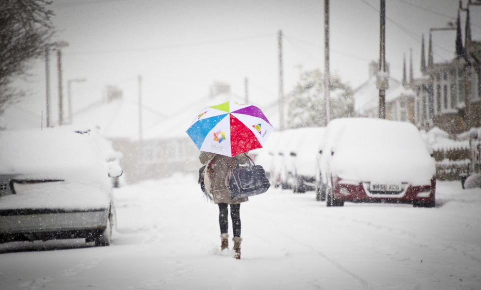 Venturing out: A woman makes her journey regardless of the weather in a very snowy Oddown Bath, Somerset