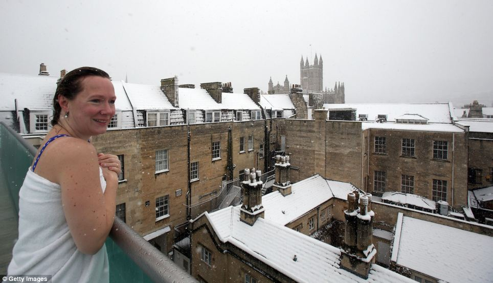 Warmed up: A bather has no need to wrap up warm after enjoying a dip in the outdoor Thermae Bath Spa in Bath