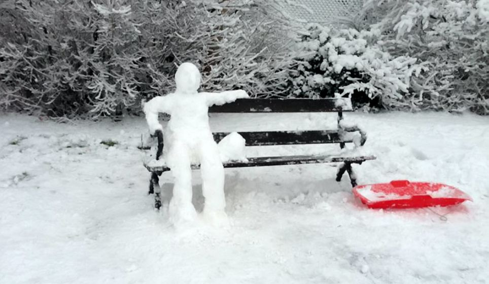 Craftsmanship: A carefully constructed snowman sits on a bench in Bristol, where some people having been taking full advantage with a day off