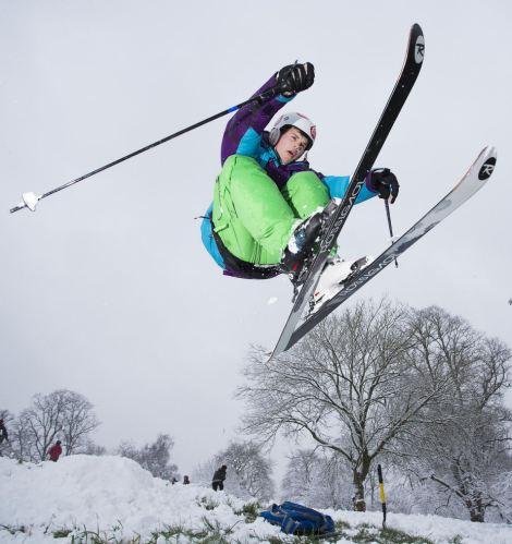 Skills: Rob Clarke, 23, takes to the air during a ski trip to Brandon Hill, Bristol