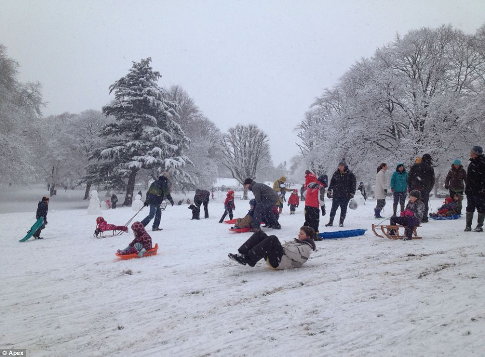 School's out: Children and adults alike flocked with their sledges to St Andrew's Park in Bristol to enjoy the unscheduled day off
