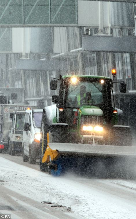 Convoy: A snow plough leads the way for a variety of vehicles hoping to keep Heathrow, Britain's busiest airport, ticking over despite the conditions