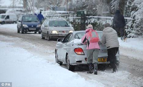 A car stuck on a snow covered road