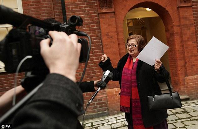 Nadia celebrating winning her case outside her barrister's chambers