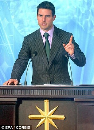 Scientology's star: Tom Cruise, seen at the opening of a new Church of Scientology in Madrid, Spain, is the subject of an explosive new book on the shadowy organisation