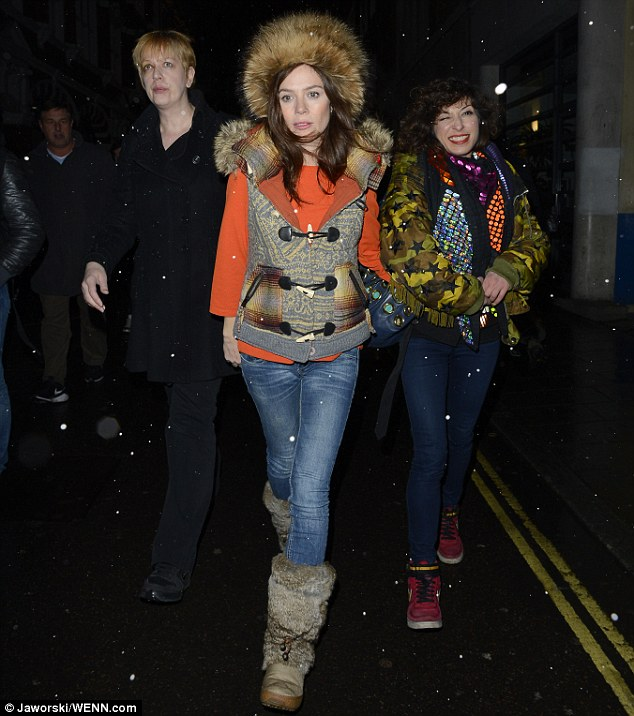 Snow bunny: Anna Friel left London's Vaudeville Theatre leaving a somewhat over-the-top hat on Friday evening