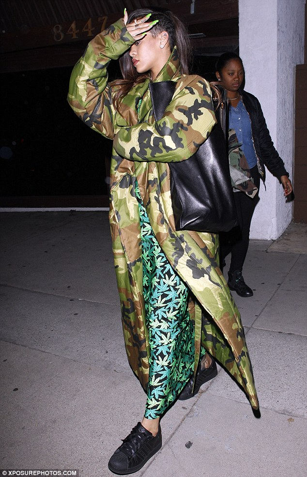 Courting controversy: Rihanna was again dressed in green, courting controversy as she paid homage to marijuana with a patterned maxi dress