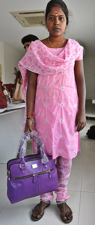 Costly: A worker with one of the dearer violet bags, at £225